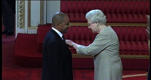 Receiving the OBE from HM The Queen in 2009